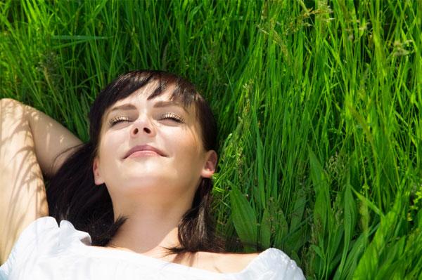 Single woman relaxing in grass
