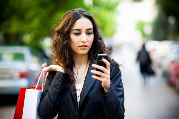 Woman on smartphone running errands