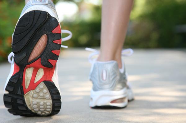 Woman running in sneakers