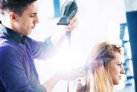 Woman getting salon blowout