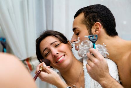 Woman sharing bathroom with man