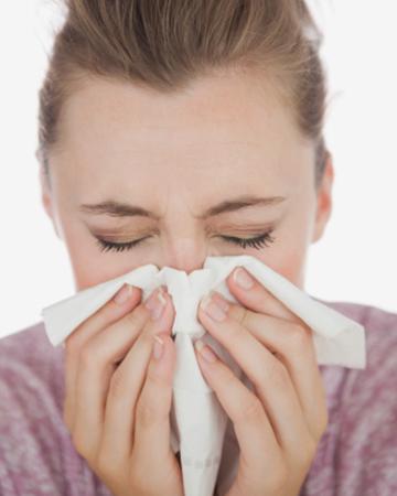 Woman sneezing | Sheknows.com