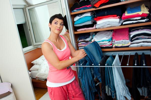Woman sorting through closet