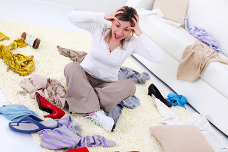 Stressed woman in cluttered room