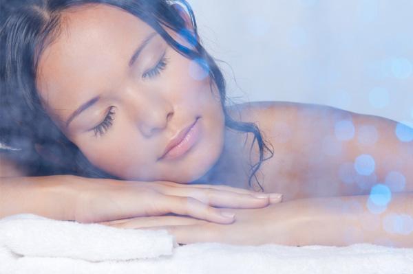 Woman taking steam bath