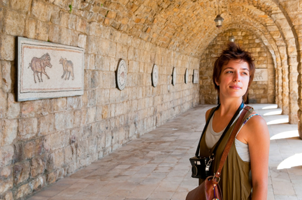Young female tourist with camera at Beiteddine Palace in Lebanon