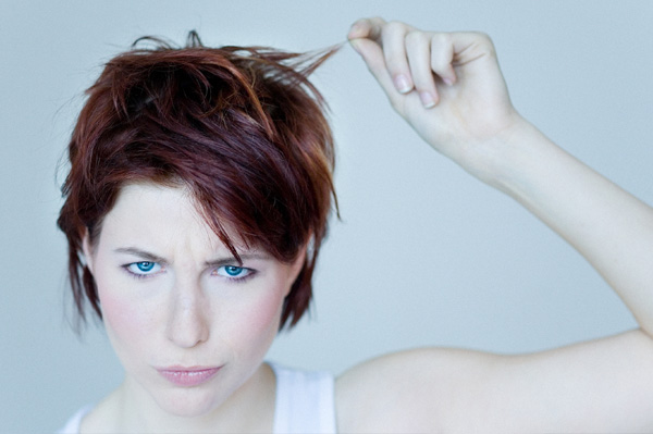 Woman upset with hair color