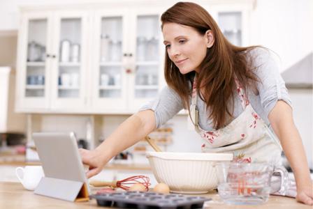 Woman baking and using iPad