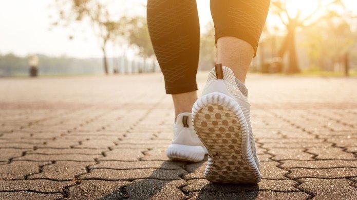 Woman's feet walking on a brick