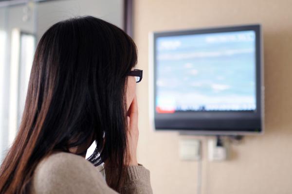 Woman watching news