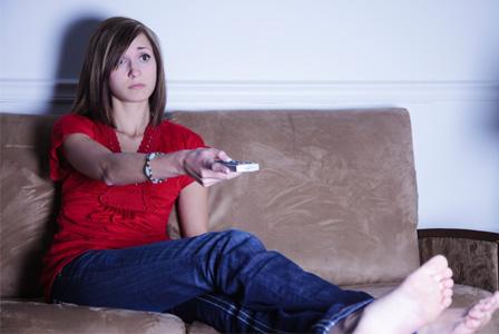 Woman watching tv late at night