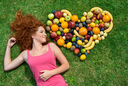 Woman in pink with fruit