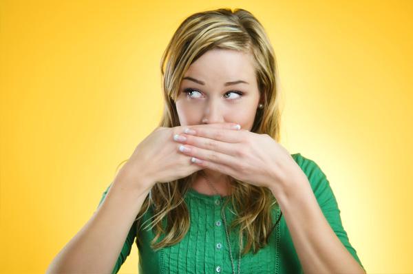 woman hiding bad breath