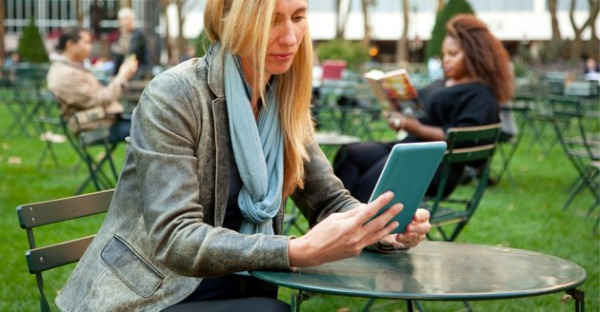 woman with ereader and bistro table