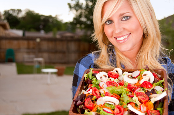 Woman with farmers market salad
