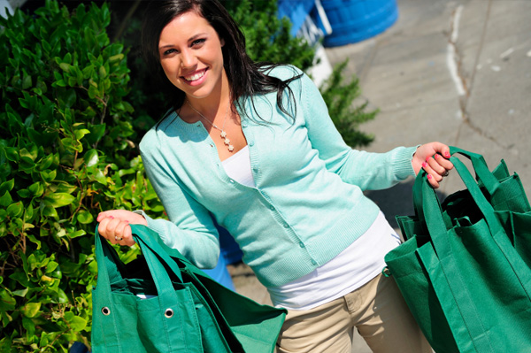 Woman with cloth shopping bags