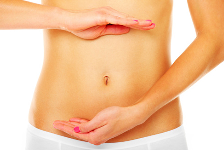 Woman with hands indicating digestive system | Sheknows.ca