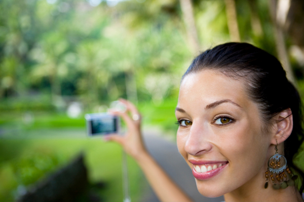 Woman with point and shoot camera