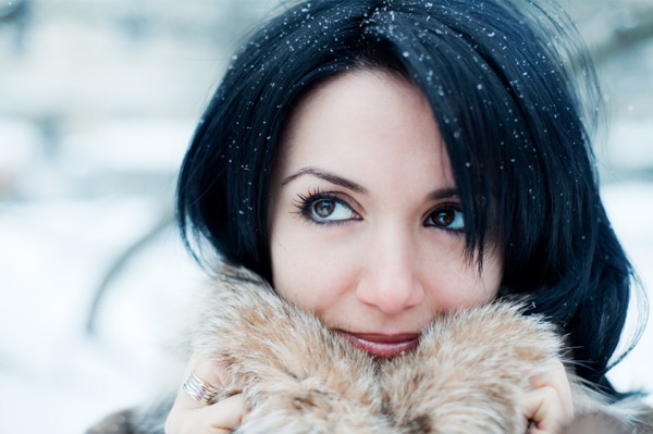 Woman in snow with winter skin