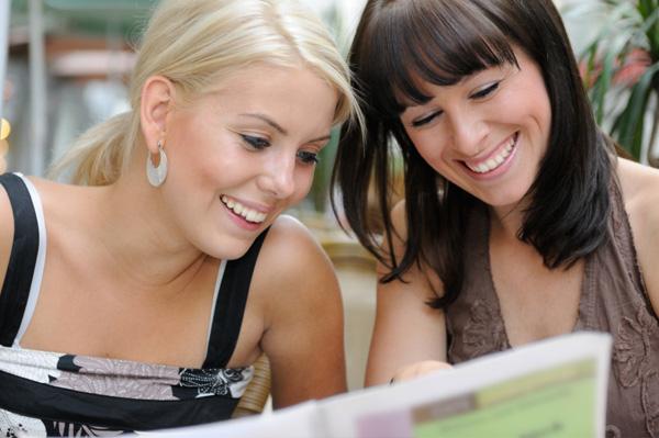 Women looking at menu