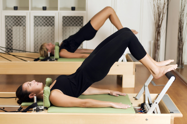 Women on Pilates Machines