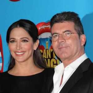 PHOTOS: Proud papa Simon Cowell shows