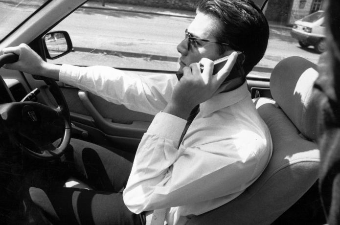A driver making a call on