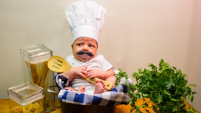 Baby dressed up as a chef