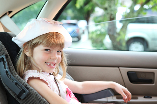 Young girl in booster seat
