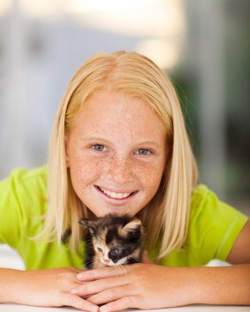 Little girl with small kitten