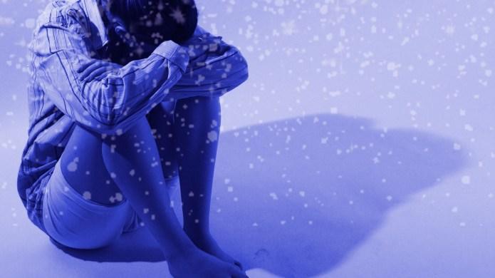 Sad woman in snowy backdrop