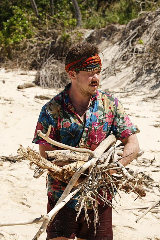 Zeke Smith works at camp on Survivor: Millennials Vs. Gen-X