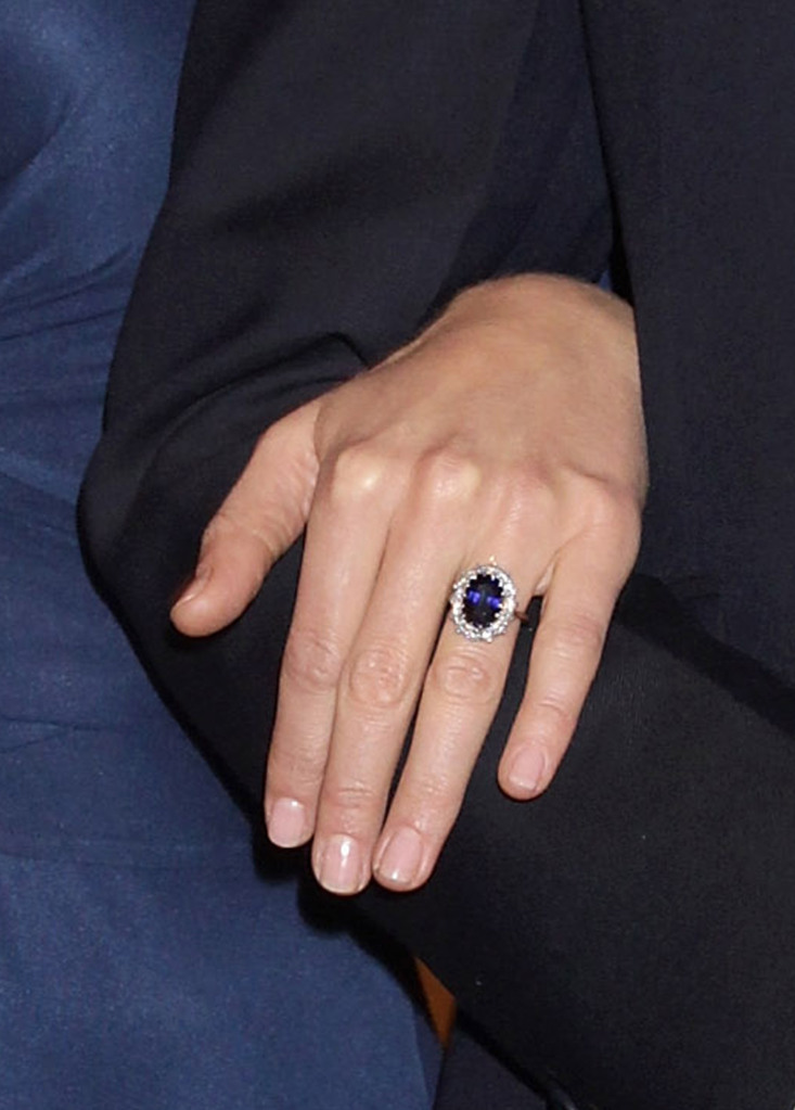 LONDON, ENGLAND - NOVEMBER 16: A close up of Kate Middleton's engagment ring as she and Prince William pose for photographs in the State Apartments of St James Palace on November 16, 2010 in London, England. After much speculation, Clarence House today announced the engagement of Prince William to Kate Middleton. The couple will get married in either the Spring or Summer of next year and continue to live in North Wales while Prince William works as an air sea rescue pilot for the RAF. The couple became engaged during a recent holiday in Kenya having been together for eight years. (Photo by Chris Jackson/Getty Images)