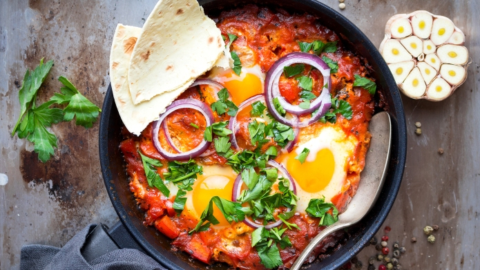 Shakshuka with pita bread in a