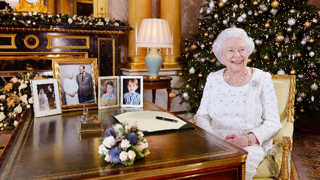 Queen Elizabeth II sits at a desk in the 1844 Room at Buckingham Palace, after recording her Christmas Day broadcast