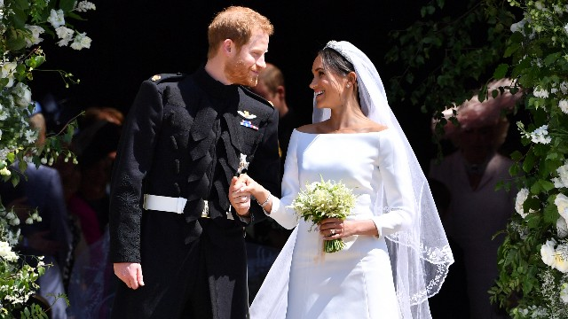 Prince Harry, Duke of Sussex and his wife Meghan, Duchess of Sussex leave from the West Door of St George's Chapel, Windsor Castle