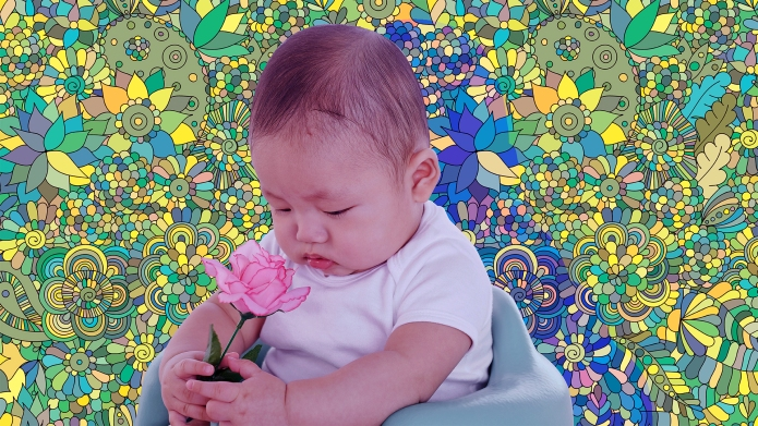 Asian baby holding flower