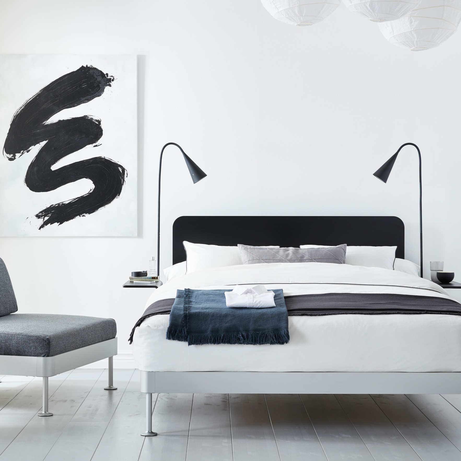 Ikea Tom Dixon Delaktig bed frame with black headboard and lamps