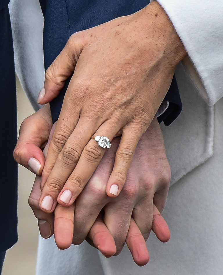 LONDON, ENGLAND - NOVEMBER 27: A close up of Meghan Markle's engagement ring during an official photocall to announce the engagement of Prince Harry and actress Meghan Markle at The Sunken Gardens at Kensington Palace on November 27, 2017 in London, England. Prince Harry and Meghan Markle have been a couple officially since November 2016 and are due to marry in Spring 2018. (Photo by Samir Hussein/Samir Hussein/WireImage)
