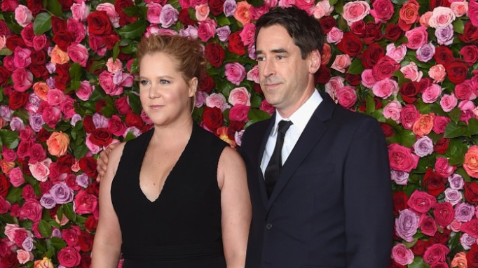 photo of amy schumer and chris fischer