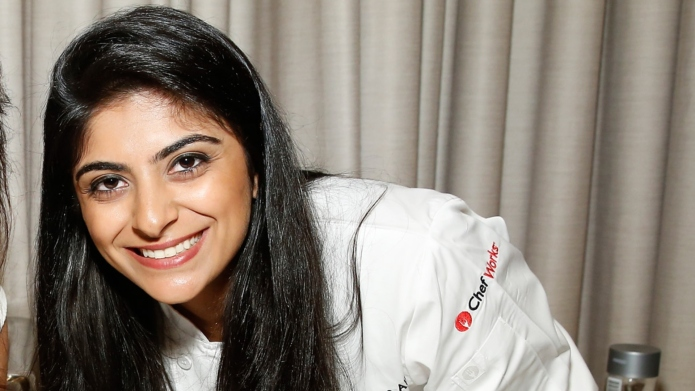 Chef Fatima Ali (R) prepares food