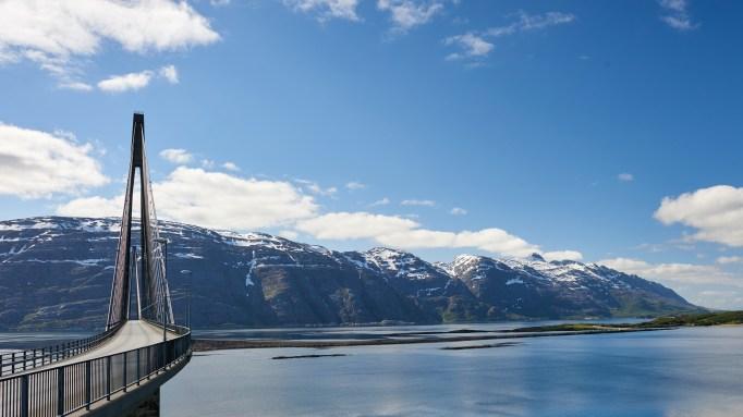 View of Helgeland Bridge and the seven sisters mountain range in Sandnessjøen, Norway.