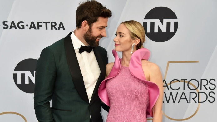 John Krasinski and Emily Blunt attend