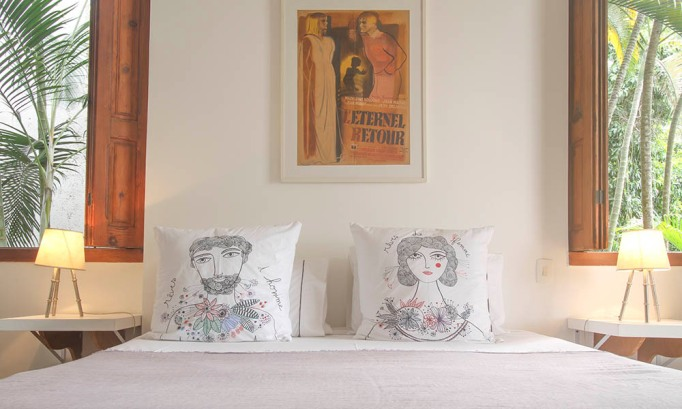 Printed pillows in bedroom at Mama Ruisa, Rio de Janeiro, Brazil