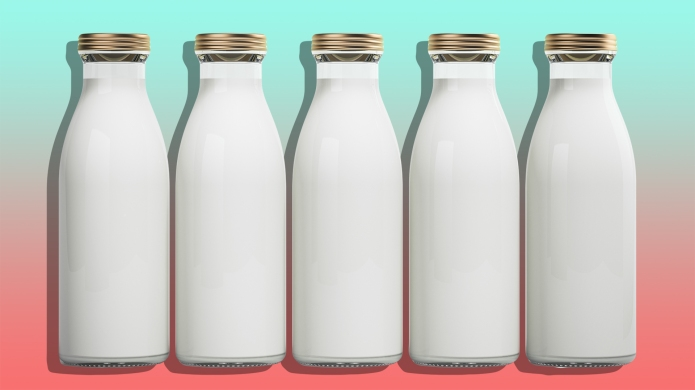 Five bottles of milk isolated on