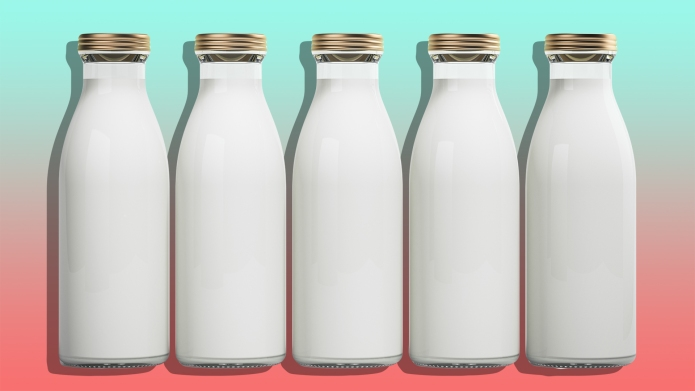 Five bottles of milk isolated on