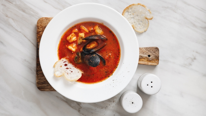 Tomato soup with seafood (cacciucco fish