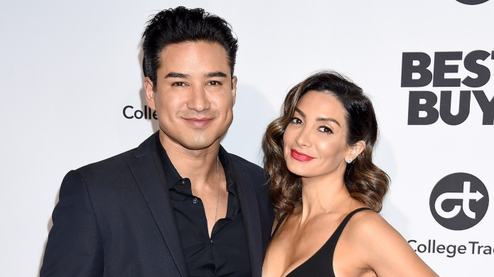 Mario & Courtney Lopez arrive at