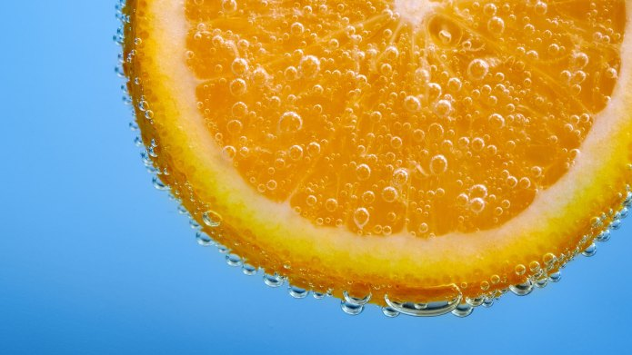 Orange slice in water.