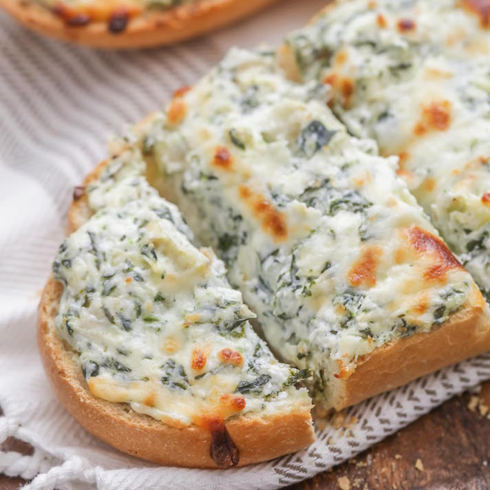 12 Easy Recipes You Can Serve In a Bread Bowl: Cheesy Spinach Artichoke Dip